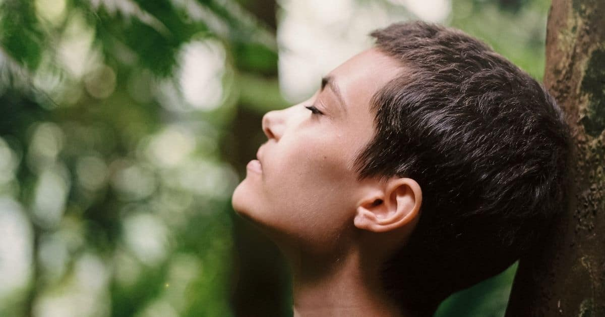 woman breathing out stress