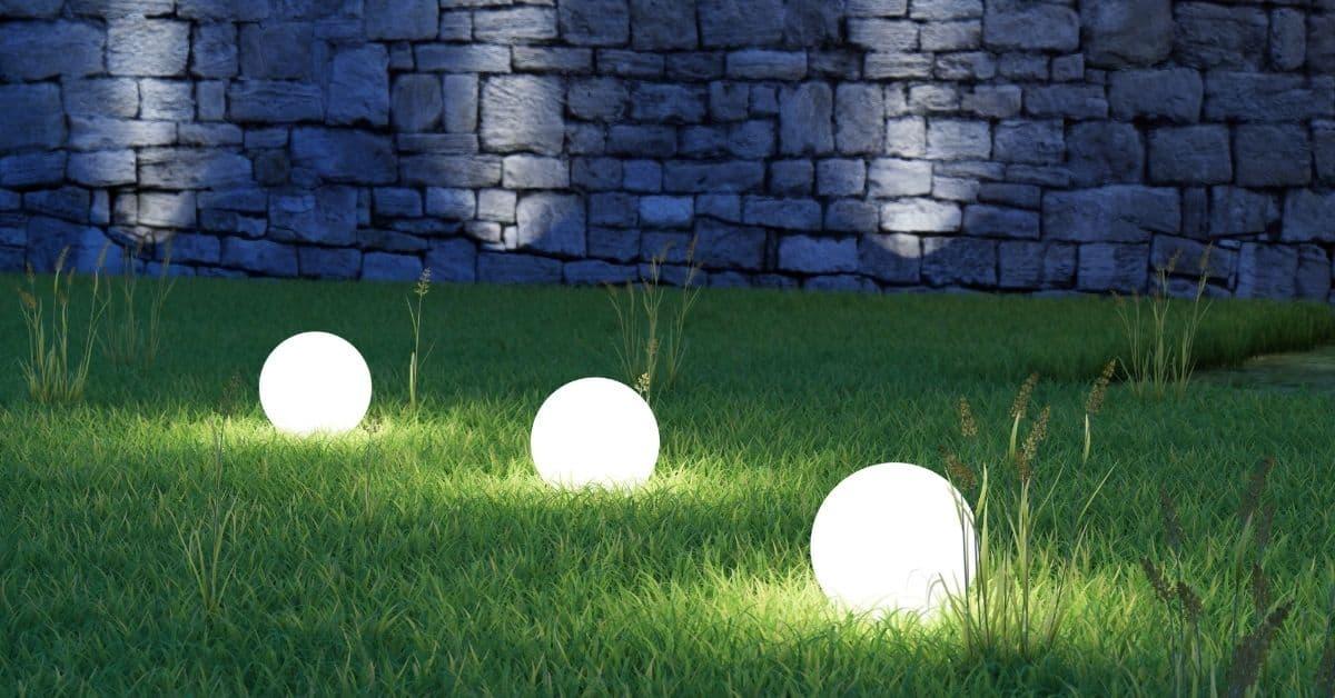 glowing solar spheres in yard at night